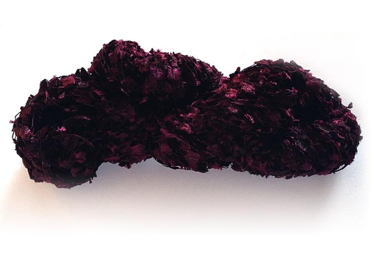 Garnet in Ticklish (100% nylon novelty flag yarn). Click the photo to see this yarn in my Etsy shop.